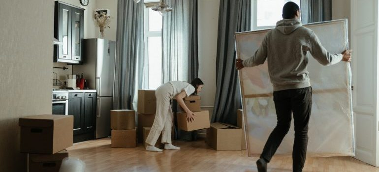 A man and a woman packing items