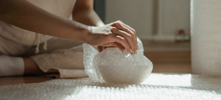 A person using bubble pack