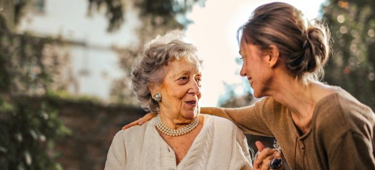 An elderly woman and her daughter talking about moving plans.