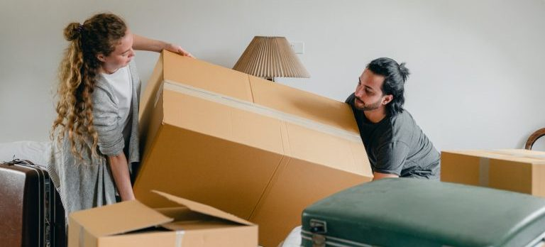 A couple struggling to move because they didn't know its important to hire professional packers for moving your art collection